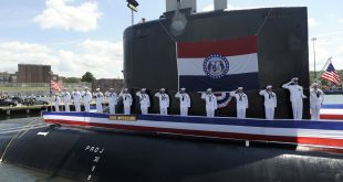 100731-N-8467N-006 GROTON, Conn. (July 31, 2010) Sailors salute during the commissioning ceremony for the Virginia-class attack submarine USS Missouri (SSN 780). Missouri is the seventh Virginia-class submarine. (U.S. Navy photo by John Narewski/Released)
